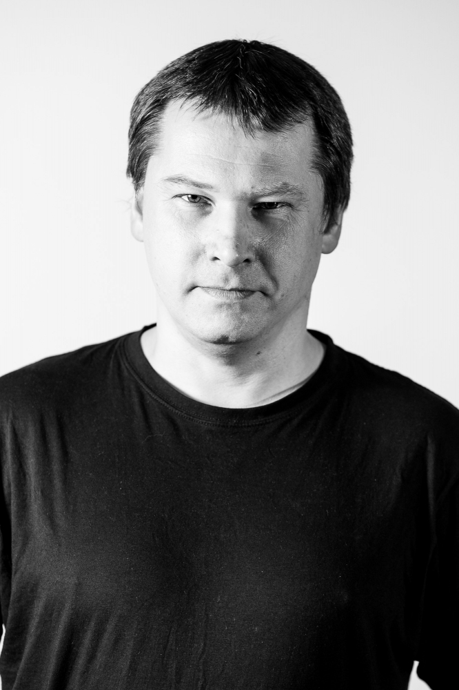 Na zdjęciu fotografia prelegenta - Tomasza Mielecha